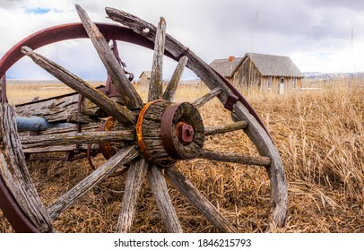 Wagon wheel broken on rustic scene