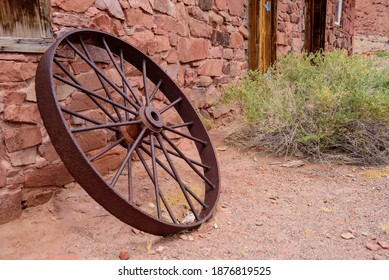 Wagon wheel leaning against the ruins at Lee's Ferry on the Colorado River.