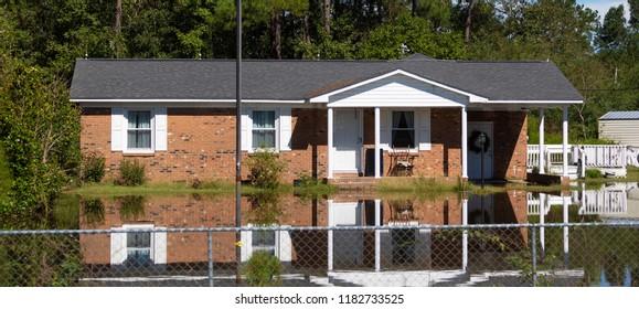 Wagram, North Carolina, United States/September 18, 2018: Flood waters backing up on a bridge just south of Raeford North Carolina after Hurricane Florence