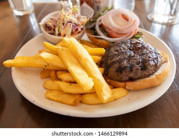 Wagyu beef burger with French fries and coleslaw
