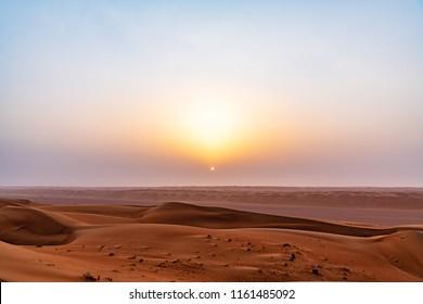 Wahiba Sands in Oman at sunrise. It is known as Sharqiya Sands or Ramlat al-Wahiba.