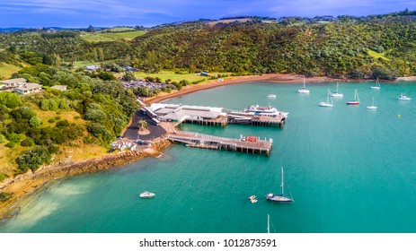 Waiheke Island, Auckland, New Zealand – January 10, 2018: Aerial view on a small pier with ferry ready for departure.