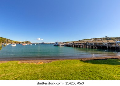 Waiheke Island, Auckland, New Zealand – June 09, 2018: View of a small pier with ferry ready for departure  in Waiheke Island, New Zealand