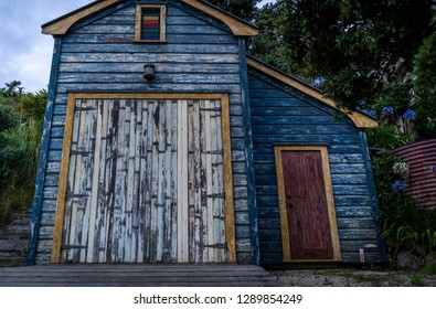 Waiheke Island, New Zealand - January 19, 2019: A colourful boatshed at Little Oneroa beach on Waiheke Island.  This island near Auckland is one of the most popular visitor attractions in New Zealand