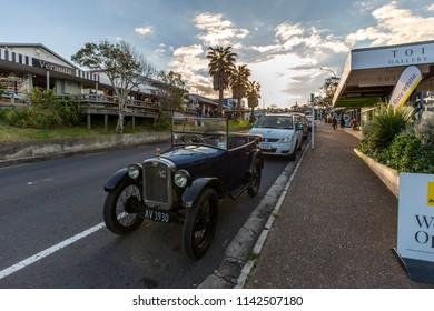 Waiheke Island, New Zealand - June 09, 2018: Old car on the roads of Waiheke Island, Auckland, New Zealand