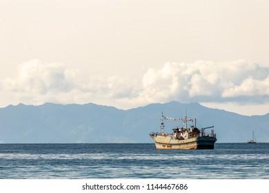Waiheke Island, New Zealand - June 09, 2018: Boat resting in a sunny harbour at Waiheke Island, New Zealand