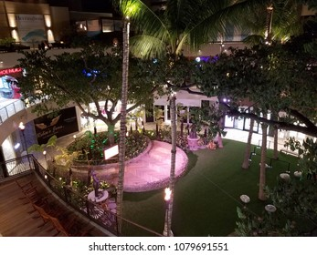 Waikiki - August 29, 2016:  Outdoor courtyard at night inside the New International Marketplace Shopping Center.