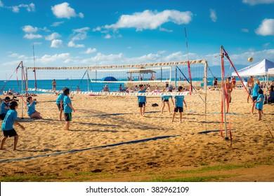 Waikiki Beach Area, Honolulu, Hawaii, USA - Dec 11, 2015: Local school children playing beach volleyball on a sunny mid-afternoon outing. Image taken adjacent to Kuhio Beach Park, Waikiki Beach Area.