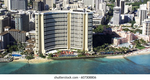 WAIKIKI BEACH, HONOLULU, HAWAII - MARCH 19. 2017: Aerial view of Waikiki Beach showing the landmark curved Sheraton Waikiki Hotel and various other hotels, condominiums and buildings.