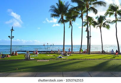 Waikiki beach, Oahu, Hawaii, Honolulu, people relax on the shore of the ocean