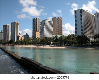 Waikiki beach in Oahu, Hawaii hotel builings in background