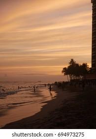 Waikiki Beach and the Pacific Ocean at sunset on Oahu, Hawaii.