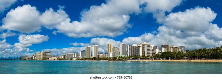 Waikiki beach skyline with blue sky and white cloud