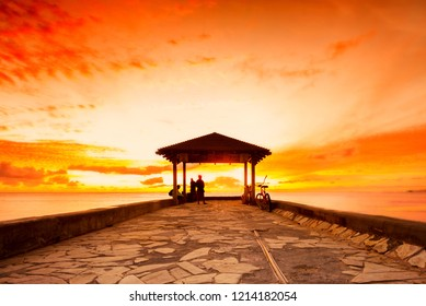 Waikiki Beach walls pier at a golden hour sunset
