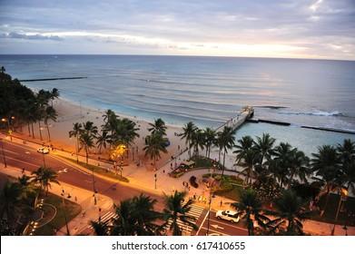 Waikiki Coastal Road at dusk. Honolulu, Oahu. Hawaii