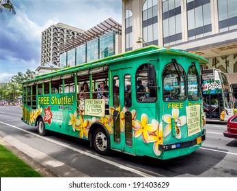 WAIKIKI, HAWAII - APRIL 25: Hilo Hattie's bus on Kalakaua avenue in Waikiki on April 25, 2014. The Hilo Hattie's shuttle is a free shuttle from Waikiki to the famous Hilo Hattie's store in Honolulu.
