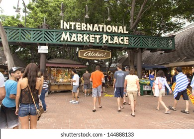 WAIKIKI, HAWAII - DECEMBER 24: The International Marketplace on December 24, 2012.  This open-air market features over 130 vendors under the banyan trees in the heart of Waikiki.