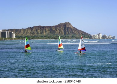 WAIKIKI, HAWAII - FEBRUARY 18, 2015: View of boats floating past Diamond Head in Honolulu, Hawaii.  Diamond Head is a defining feature of the view known to residents and tourists of Waikiki.