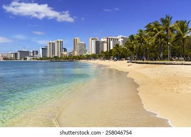WAIKIKI, HAWAII - FEBRUARY 18, 2015: View of Waikiki beach waterfront in Honolulu, Hawaii. Waikiki white sand beach shoreline is Hawaii's most famous beach.