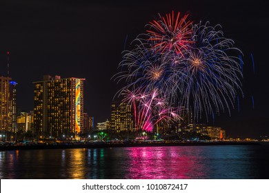Waikiki, Hawaii, Oahu - January 26, 2018:  Every Friday night, the Hilton Hawaiian Village Resort puts on a fireworks display show for its guest and visitors at large off of Waikiki Beach.