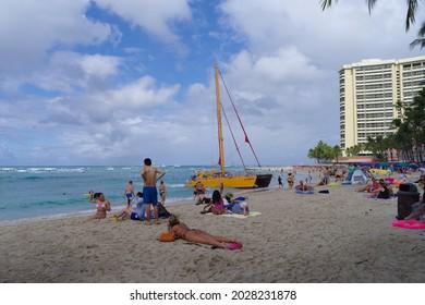 Waikiki, Hawaii, USA - August 19, 2021: this image shows a morning typical beach scene.