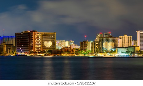 Waikiki, Hawaii, USA - May 10, 2020: The Sheraton Waikiki and Moana Surfrider hotels celebrated Mother's Day by lighting up their hotel buildings with a heart shaped message