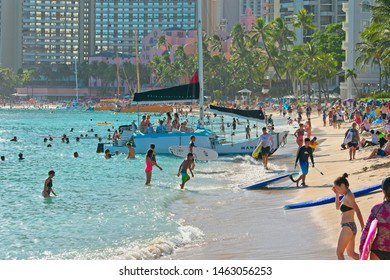 Waikiki, HI, USA - July 21. 2019: Tourists enjoying a sunny day on Waikiki beach.