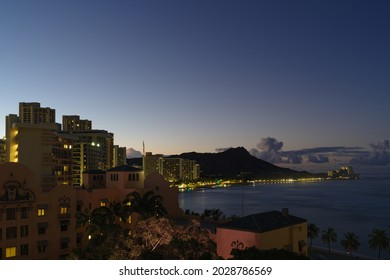 Waikiki, Honolulu, Hawaii - August 17, 2021: this image shows a view of Waikiki at dawn. The landmark Royal Hawaiian Hotel is partially shown in the foreground.