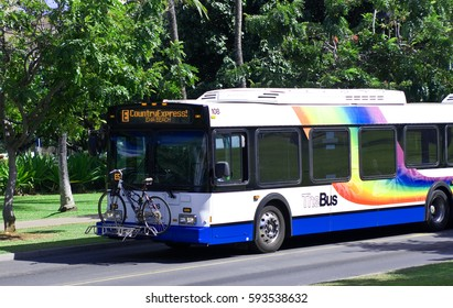 WAIKIKI, HONOLULU, HAWAII - MARCH 28, 2012: The Bus Country Express travels through Waikiki and is the official public bus service on the island of Oahu.