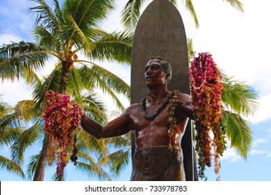 """WAIKIKI, OAHU, HAWAII/UNITED STATES – JANUARY 7, 2013: Duke Kahanamoku iconic statue. Duke is considered """"The father of modern surfing"""", a master of swimming, surfing and outrigger canoe paddling."""