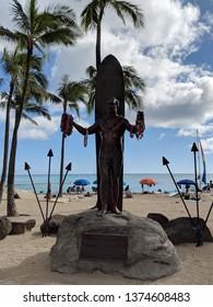 Waikiki - September 4, 2018: Duke Kahanamoku statue holding leis at Waikiki Beach. Duke is a legendary athlete of Hawaii and the ambassador of Aloha.