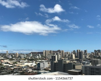 Waikiki skyline with Diamondhead crater and the Pacific Ocean in the background.
