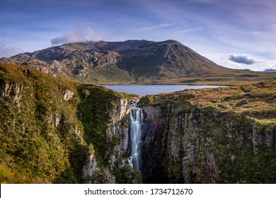 Wailing Widow Falls, Loch na Gainmhich, Glas Bheinn, in the dramatic highlands of scenic Scotland, a fantastic adventure travel destination for a holiday vacation to view awesome picturesque scenery - Shutterstock ID 1734712670