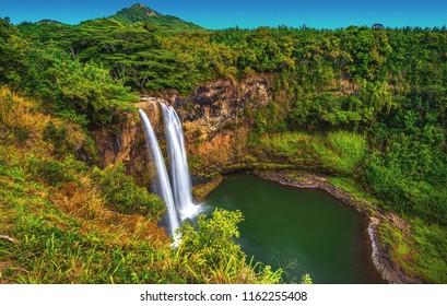Wailua Falls cascading over a 173 foot drop into the jungle on the island of Kauai, Hawaii.  USA