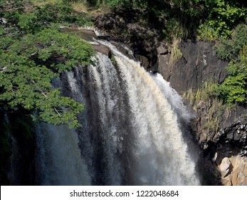 """Wailua Falls - Dramatic double waterfall known for rainbows & its place in the """"Fantasy Island"""" opening credits."""