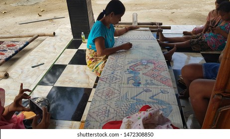 WAINGAPU, EAST SUMBA/INDONESIA - April 27, 2019: Women weaving traditional fabric, called Tenun Sumba. All production in Sumba is handmade, not used an electric machine. Natural dyes, not synthetic.