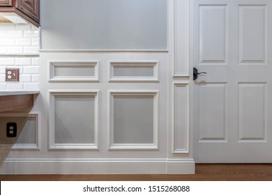 Wainscot paneling with  moldings and door