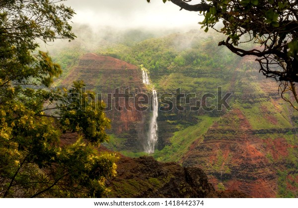 Waipo'o Falls, Waimea Canyon, Kauai, Hawaii. Waipo'o Falls is a fantastic waterfall on Kokee Stream dropping 800 ft. in two tiers. It is located in the heart of the Waimea Canyon.