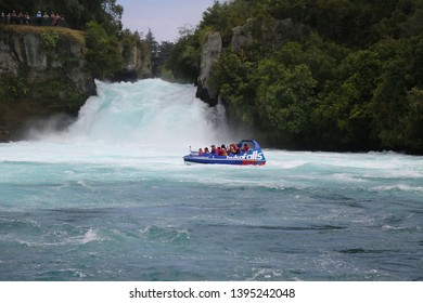 WAIRAKEI, NEW ZEALAND - FEBRUARY, 1, 2019: Hukafalls jet boat takes tourists on fast ride on Waikato River to Huka Falls in Taupo