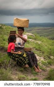 Wairinding hill, Waingapu, East Sumba, East Nusa Tenggara, Indonesia - November 2017 : Mother helping her daughter at Wairinding hill