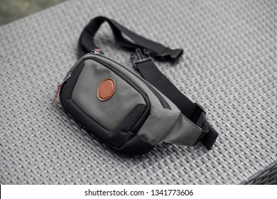 waist bag lies on a gray background