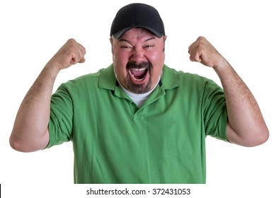 Waist Up of Excited Man with Goatee Wearing Green Shirt and Baseball Cap Holding Fists in Air and Celebrating Team Win in Studio with White Background