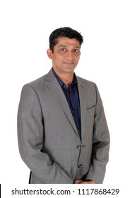 A waist up image of a handsome business man in a gray suit and blue