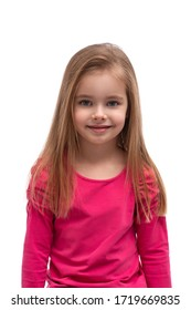 Waist up portrait of a cute blonde smiling little girl with long hair and blue eyes against white background in studio
