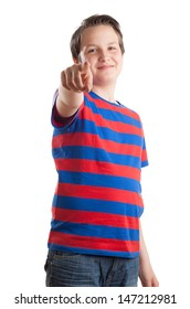 Waist up portrait of a teenager (13 years old) Caucasian boy standing and pointing to the camera, isolated on white background.