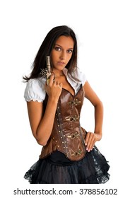 Waist Up Portrait of Young Brunette Woman Wearing Old Fashioned Western Costume with Corset and Tutu Holding Antique Pistol and Standing in Studio with Hand on Hip in White Studio