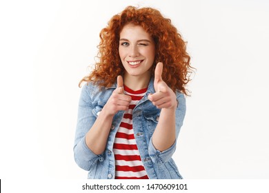 Waist-up cheeky good-looking redhead female giving hint winking playfully pointing finger pistols sassy camera inviting friend come dance together standing white background upbeat