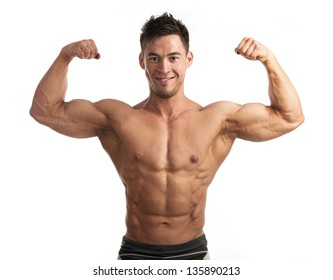 Waist-up portrait of muscular man flexing his biceps against white background