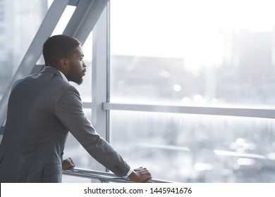 Wait for Flight. Afro Businessman Looking Through Window in Airport