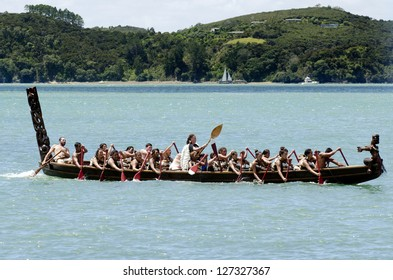 WAITANGI - FEB 6:Maori warriors rows a war canoe during Waitangi Day on February 6 2013 in Waitangi NZ.It's a New Zealand public holiday to celebrate the signing of the Treaty of Waitangi in 1840.
